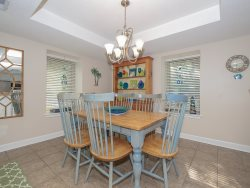 Dining Area at 1704 Bluff Villa has a table with seating for 8