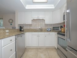 1704 Bluff Villa - Kitchen includes a breakfast bar that seats 2