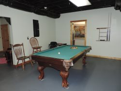 The pool table in the game room downstairs.