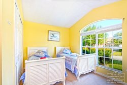 Davenport Vacation Rental in West Ridge - Twin Bedroom with large windows