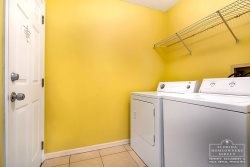 Davenport Vacation Rental in West Ridge - Laundry room with Full Sized Washer and Dryer