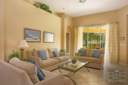 Calabay Parc at Tower Lake Disney Community- Living area with patio view