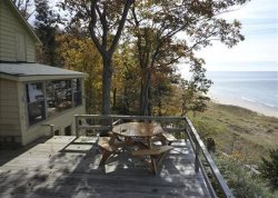 Grand Haven Cottage Rental with Shared Private Beach and Lake Michigan Views!