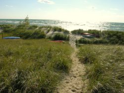 Grand Haven Cottage Rental with Shared Private Beach!
