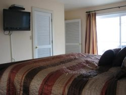 Optiaqua - Main Level - Master Bedroom - Flat Screen TV and Glass Slider To Deck