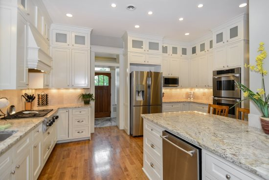 Gourmet kitchen deluxe appliances, wood floors