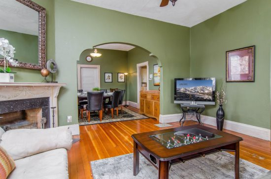 Family room with vintage wood floors, sofas, TV