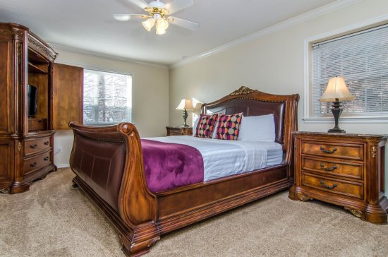Master bedroom with king sleigh bed and flatscreen TV