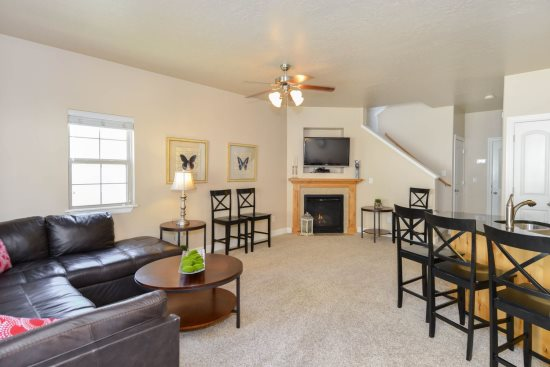 Family room with sectional, fireplace, TV open to kitchen