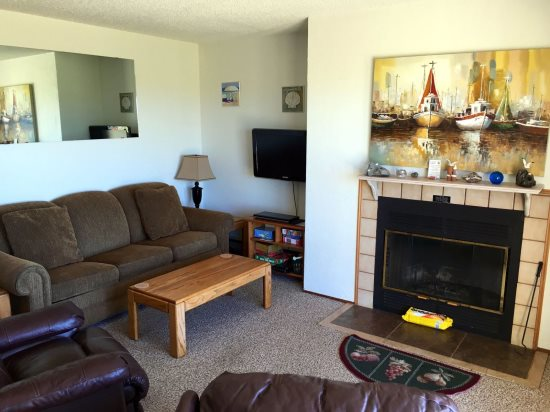 Living Room with Color TV and Fireplace