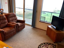 Living Room with Fireplace. Ocean view, and color HDTV