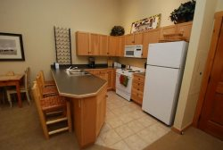 Fully equipped kitchen with a breakfast bar seating three guests