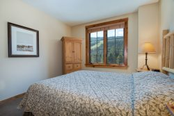 Comfortable master bedroom with a  king bed