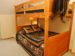 Spacious guest room with double beds and a twin trundle