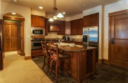 Deluxe kitchen with stainless steel appliances and granite countertops
