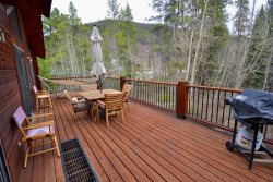 Spacious outdoor deck with a gas grill and patio furniture