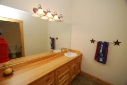 En suite bathroom with wooden counter space
