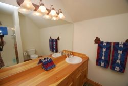 Full en suite bathroom with wooden countertops