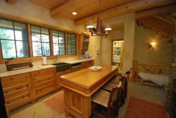 Deluxe country styled kitchen featuring an island with three barstools