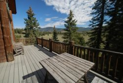 Large deck with patio seating offering panoramic views of the Keystone Ranch valley