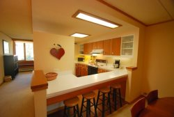 Kitchen featuring a breakfast bar for four guests