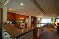 Fully equipped kitchen with updated cabinetry and wood floors