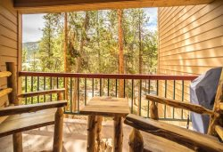 Outdoor balcony with forest views and a gas grill for afternoon barbecues