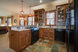 Deluxe kitchen with granite countertops and a tile floor