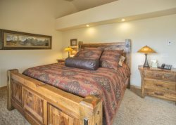 Comfortable mountain style bedroom with a king bed