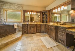 Luxurious bathroom with granite counters and a glass walk in shower