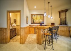 Gourmet kitchen with granite counter tops and a breakfast bar for four guests
