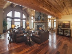 Spectacular red cedar log estate in the exclusive gated community of Ruby Ranch