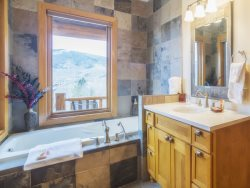 En suite bathroom with a deep soaking tub