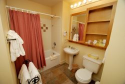 Full bathroom with tile floors and a deep soaking tub