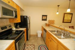 Full kitchen with tile floors and stainless steel appliances