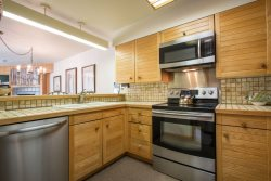 Full kitchen featuring stainless steel appliances