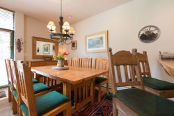 Wood dining room table accommodating up to six guests