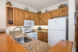 Fully equipped kitchen with tile floors and granite countertops