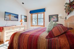 Warm, cozy bedroom with a king bed