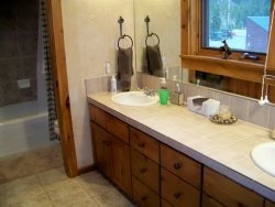 Deluxe bathroom with updated cabinetry and dual sinks