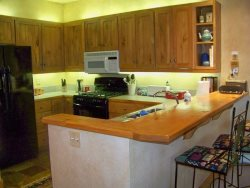 Fully equipped kitchen with a breakfast bar seating up to three guests