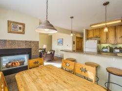 Fully equipped kitchen with a breakfast bar for three guests