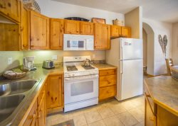 Full kitchen with knotty wood furnishings