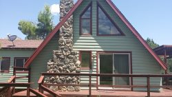 Cute, cozy, relaxed little cabin nestled in a .45 acre lot on the outskirts of town JACKS -S017