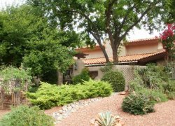 Spanish Style Ranch Home sits on a 1/2 acre in the Red Rock Cove Subdivision