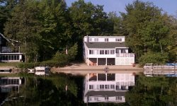 Gorgeous Waterfront Home with Sandy Beach, Boat Dock, Screened Porch