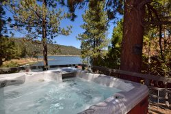 Cozy Lakefront where you can lounge lakefront at this Cozy Cabin Vacation with outdoor hot tub and close to shopping in Big Bear.