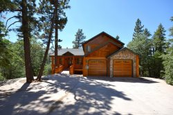 Enjoy amazing views of the mountains and lake from this Big Bear cabin rental, with hot tub, near Bear Mountain Ski Resort.
