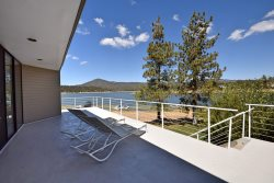 Big Bear Lakefront has beautiful views of the lake from inside and outside along the large deck.