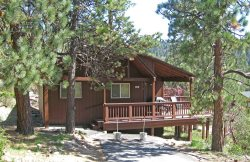 Boulder Bay Getaway is a cozy, pet friendly vacation cabin in Big Bear, with scenic views of the pine trees.